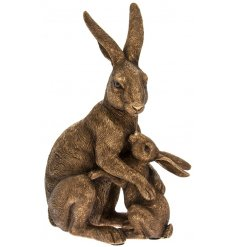A gorgeous ornamental Hare And Baby ornament set with a bronzed tone