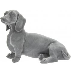 A simple themed ornamental Dachshund figure in a cute laying pose
