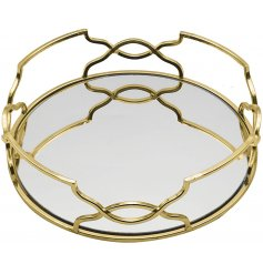 Perfect for bringing a stylish Gatsby touch to any home decor, a small round mirrored tray with a detailed edging