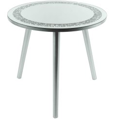 Sure to add a glitzy statement to any home space, a tall 3 legged table with a rounded shaped mirrored glitter top