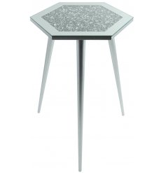 Sure to add a glitzy statement to any home space, a tall 3 legged table with a hexagon shaped mirrored glitter top