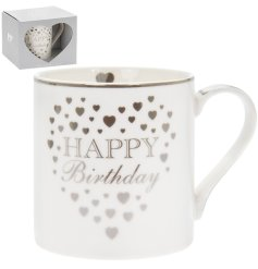 A sleek white China Mug featuring silver trims, heart motifs and a scripted Happy Birthday Text
