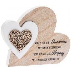 A charming natural wooden heart with an added heart shaped puzzle piece in a white tone and scripted text decal