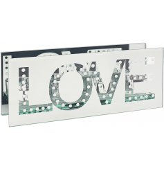A gorgeously set mirrored 3 space tlight holder with an added LOVE text decal and sleek design