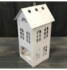 An overly rustic inspired metal house shaped tlight holder