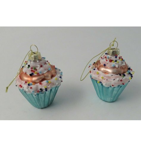 A small hanging cupcake decoration topped with glitter and sprinkles