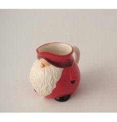 Perfect for serving up beverages at all Festive events, a Red Santa Jug with an added nordic tone