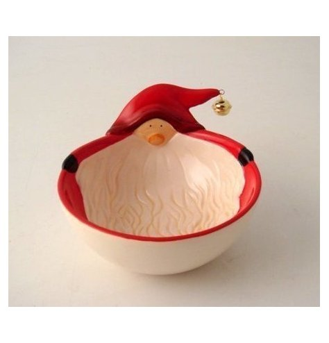 A small ceramic snack dish with a cute red and white toned Santa decal