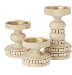 A set of 3 candle stands with carved details and beaded trims