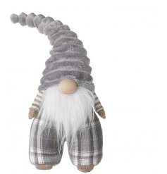 A charmingly plump fabric gonk with checkered print trousers and a soft grey hat