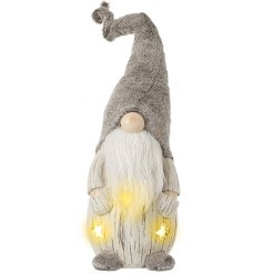 A charmingly festive inspired standing gonk figure complete with a faux fur hat and warm glowing LEDs
