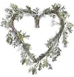 With added glittery touches and white berry features, this artificial heart wreath is a must have for the home at Christ
