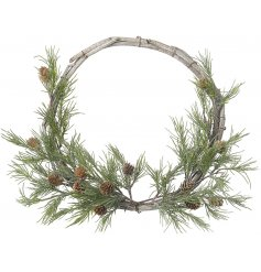 A plain and simple rounded twig wreath entwined with a beautiful fir branch cluster at the bottom