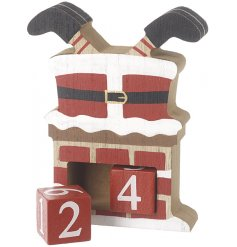A wooden advent in the shape of Santa stuck in a Chimney!