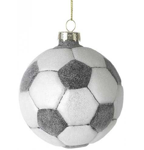A glass bauble unusually shaped as a football.