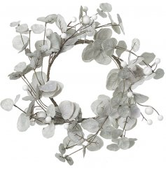A frosted grey winter wreath with white berries and a glistening of glitter detail.