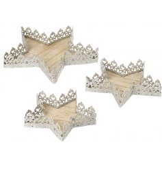 an assorted sized set of star trays with a scalloped edge to each