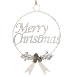 A metal wire wreath decorated with a scripted text Merry Christmas Decal and added foliage design at the bottom