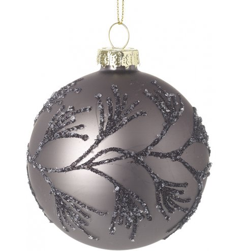A purple toned glitter covered bauble with a silver cap and glittery string