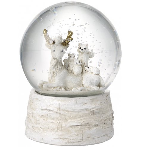 A magical winter woodland snow globe with a bark effect base and forrest friends.