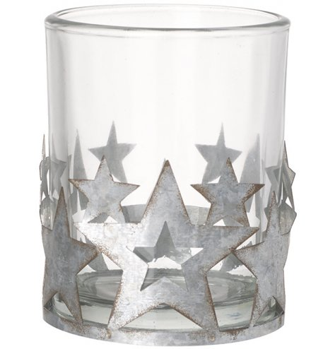 A classic glass candle holder adorned with rustic silver metal stars. Each has a rough luxe, distressed finish.