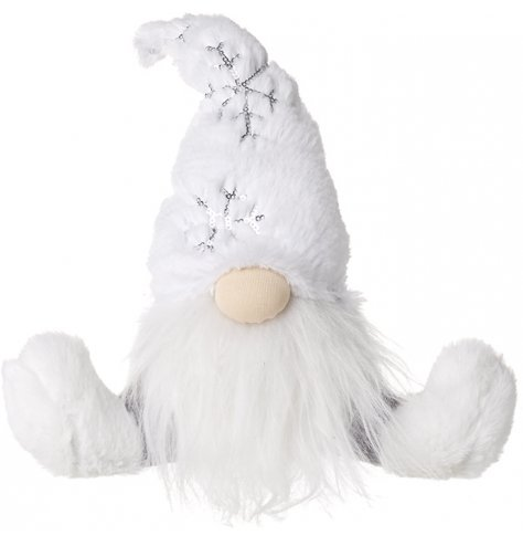 A plush and cuddly sitting fabric gonk covered in white faux fur fabrics and a high pointed hat for a traditional look