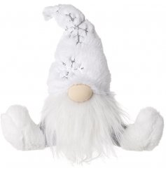 A plush and cuddle sitting fabric gonk covered with white faux fur trimmings and a sequin snowflake decal