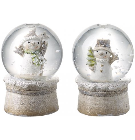 A mix of mini snow globes, both decorated with a snowman centre and flurry of snow when shook