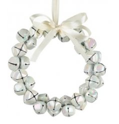 Sure to tie in with and Whimsical Wonderland inspired spaces at Christmas Time, a jingling bell wreath with an iridescen