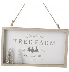A gorgeously simple themed hanging wooden plaque with a Christmas Farm printed text and bristle tree to complete its loo