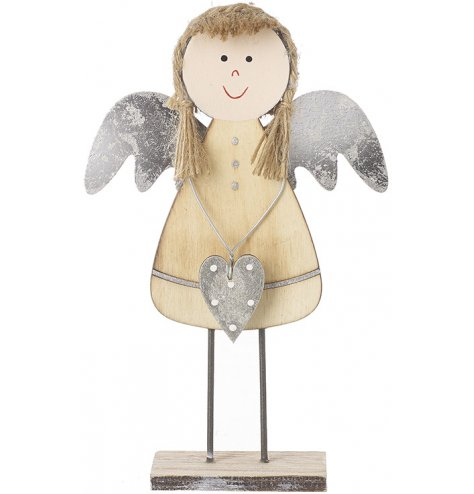 A sweet standing wooden angel complete with distressed silver features and jute string hair