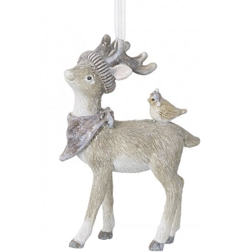 A little reindeer hanging decoration with a sprinkle of glitter and perched bird on the back