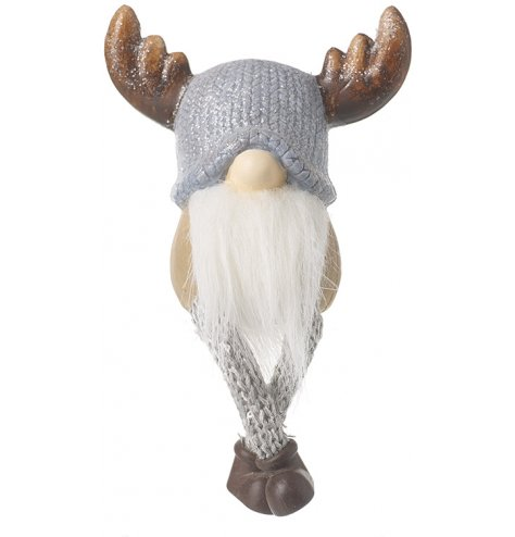 A sitting gonk figure with glittery antlers and long dangly knitted legs