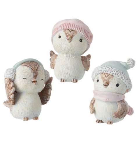 A mix of festive themed sitting owl figures complete with grey and pink hats for charm