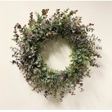 An on trend Christmas wreath with a flurry of eucalyptus foliage in green and purple hues