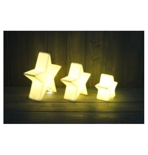 A small ceramic star with all white tones complete with a warm glowing LED central light