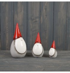 Perfect for adding a Nordic charm to your tree decor at Christmas Time, a sweet ceramic gonk with red and grey tones