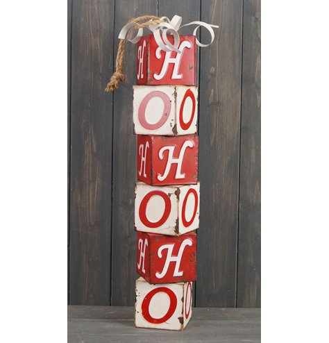 A large decorative stack of blocks that spell out HO HO HO ,