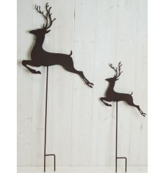 Perfect for bringing a woodland hint to your garden during Christmas Time, a set of 2 sized metal stakes with leaping Re