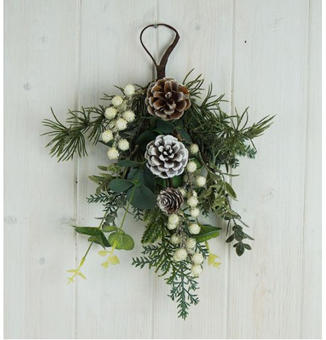 A large foliage filled bunch with added pinecone details, white berries and frosty glitter finishes