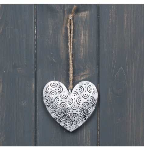 A jute string hung metal heart with a rustic look and textured decal