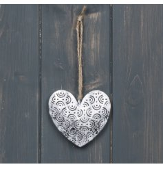 A simple accent to bring to any home space, a hanging metal heart with a patterned decal and jute string