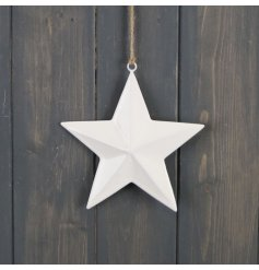 A sleek and simple hanging ceramic star with a white tone and jute string