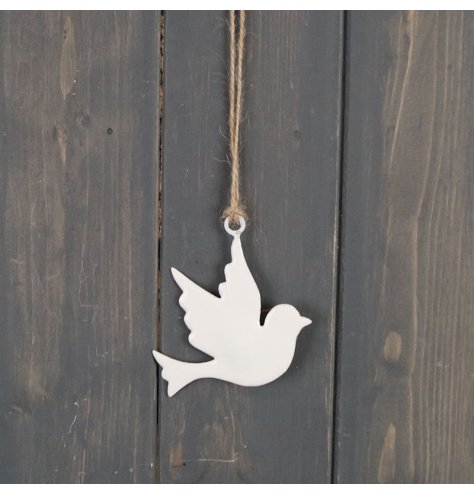 A simple inspired hanging dove decoration with a jute string and white tone finish