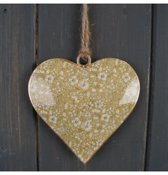 A sweet little hanging heart decoration with a yellow floral decal to its centre