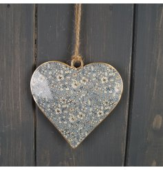 A sweet little hanging heart decoration with a blue floral decal to its centre