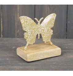 Decorated with a floral yellow decal, this butterfly on wood base is sure to bring a pop of colour to any home space