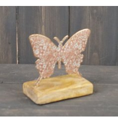 Decorated with a floral pink decal, this butterfly on wood base is sure to bring a pop of colour to any home space