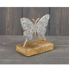 a wooden block based ornament with a butterfly decal and blue toned finish