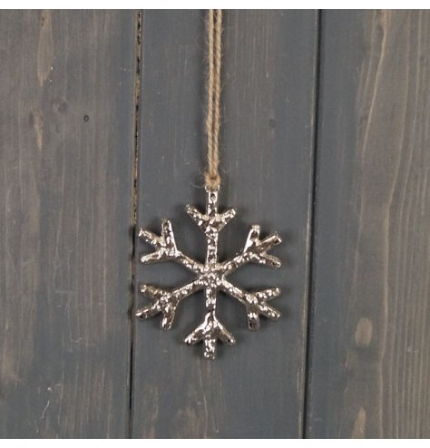 A rough luxe inspired snowflake hanging decoration with a textured silver aluminium finish. Complete with a long jute st